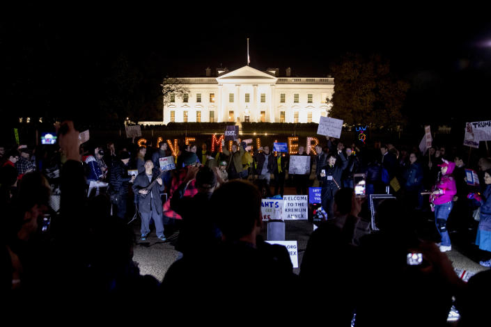 "Protesters gather in front of the White House in Washington, Thursday, Nov. 8, 2018, as part of a nationwide ""Protect Mueller"" campaign demanding that Acting U.S. Attorney General Matthew Whitaker recuse himself from overseeing the ongoing special counsel investigation. (AP Photo/Andrew Harnik)"