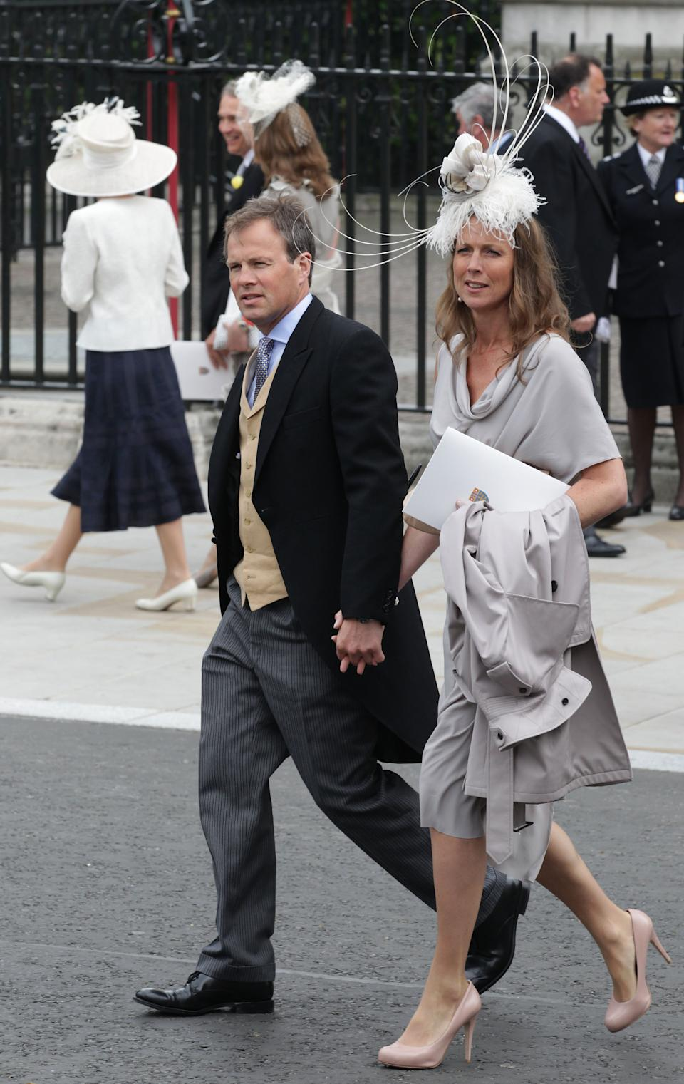 LONDON, ENGLAND - APRIL 29:  Tom Bradby from ITV News with his wife Claudia exit following the marriage of Prince William, Duke of Cambridge and Catherine, Duchess of Cambridge at Westminster Abbey on April 29, 2011 in London, England. The marriage of the second in line to the British throne was led by the Archbishop of Canterbury and was attended by 1900 guests, including foreign Royal family members and heads of state. Thousands of well-wishers from around the world have also flocked to London to witness the spectacle and pageantry of the Royal Wedding.  (Photo by Chris Jackson/Getty Images)