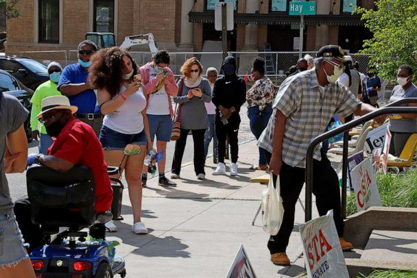 PHOTO: Residents wait in line outside the Wilkinsburg Municipal Building to cast their vote during primary voting, in Pittsburgh, June 2, 2020. (Gene J. Puskar/AP Photo)