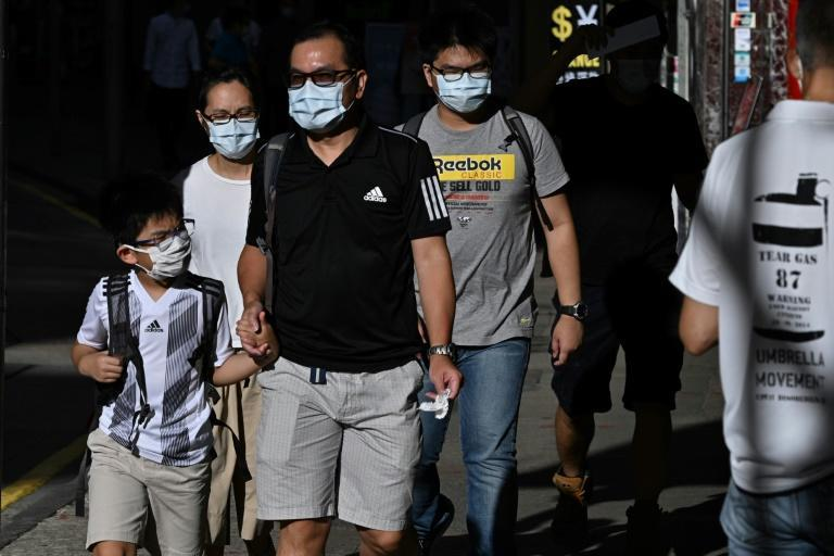 Authorities in Hong Kong made it mandatory to wear masks in public from this week and unveiled the city's toughest social distancing measures yet (AFP Photo/Anthony WALLACE)