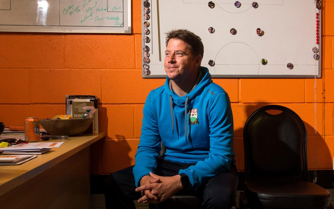 "No one can doubt that Ross Eames is a man with an eye for detail. When the Telegraph photographer asks the Barnet head coach to pose for pictures in front of the magnetic tactics board in his office, on which the starting line-up for his team's League Two encounter with Swindon Town is carefully laid out in their positions, he springs up and rapidly re-arranges the formation.  Which suggests he is concerned that his rival manager might look at the picture in order to glean information about how Barnet intend to play the match. ""Well, I know I would,"" he smiles. ""Every time."" Eames is an unusual presence on the touchline of a Football League club. For a start, at 32, he is younger than three members of the Barnet first-team squad. Moreover, unlike them, he has never played the game beyond turning out for his school team. An international gymnast in his youth (though due to dodgy knees he has not done a standing somersault for 10 years), he studied sports coaching at university before rapidly making his way up through football's academy system. After a brief spell as caretaker manager in 2016, he found himself placed in permanent charge of Barnet in May. It is some progress. Not that he sees himself as representing an advance guard for the new way. It's been a tough start to the season for Eames and Barnet, they've not won in five league and cup games, including a 1-0 Carabao Cup defeat at Brighton Credit: Gareth Fuller/PA ""I think this old school/new school thing is a myth,"" he says. ""There's loads of different ways to skin a cat. The way I do things suits me; for someone else it might not work. Yeah, my background's different. But at the end of the day it's not about me. It's about making this club a success. The direction you come from in achieving that is irrelevant. As long as you do."" A hint of the way Eames does things is evident in the list of fines pinned to the wall outside the manager's office at the club's smart new Hive stadium. There are dozens of edicts, ranging from ""eating in the physio's room: £5"" to ""not doing a sit and reach test: £10"", all of which imply he expects high standards of personal responsibility from his players. Not least in the way they perform on the pitch. ""The biggest thing for me is every player has to work hard, battle to win first and second balls,"" he says. ""When they have possession, then I do like my teams to play. But how they play depends on the moment. If we can't play round then we play through and if we can't play through then we play over the top. My philosophy is very simple: don't over-complicate."" Eames is a big admirer of former Argentina boss Marcelo Bielsa, currently coach at Lille Credit: Ricardo Mazalan/AP Like Mauricio Pochettino, working just down the road at Wembley, Eames admits to being an avid admirer of the Argentine coach, Marcelo Bielsa. ""I really like the way his teams press, the approach he has to suffocate opponents in their own half,"" he says. ""And we're on the right path here. We played Swansea in pre-season and really pushed them, didn't give them an inch."" Although he has not yet followed his tactical mentor's habit of four-hour press conferences (""I prefer to keep that side of things as brief as possible,"" he smiles) he has put in place a Bielsa-style regime at Barnet, out on the training pitch every day, working relentlessly on team shape and tactical flexibility.  In truth, it is a methodology that has yet to translate to consistent success: including cup ties, Barnet have lost their past four fixtures.  ""Really tight games, three 1-0 defeats, two of the losses against higher-league opposition,"" he says. ""But no doubt it's been a tough couple of weeks. You have to learn from it. There's always a way to make it better."" Aged 32, Eames is younger than three of his first-team squad Credit: Geoff Pugh One thing he has not done in the run of defeats is shout at his players. That, he says, would be wholly counter-productive. ""I am a thinker, very obsessive about how I want things done, not someone to go in and rant and rave,"" he says. ""I can be authoritative, yeah. But for me the most important quality is clarity: get your message across quickly and clearly. While you need to make sure it's honest, the tone of the feedback needs to be sensitive to the player. It doesn't work if all you have is the hairdryer."" He appreciates, however, that he needs to return to winning ways quickly. As is demonstrated in the pictures of Neymar, Mesut Ozil and David Luiz photographed outside the main entrance that decorate the walls of the Starbucks franchise in the stadium, this is not a club these days lacking in ambition. ""People think of Barnet as Underhill, Stan Flashman, Barry Fry, all that,"" Eames says. ""Sure, it's a club full of history, but now we're evolving. Look around you. Everything we have here is Championship standard. Brazil, Germany, Sweden have all trained here before playing at Wembley.  ""The only way we can go is up, what the chairman has created here in terms of facilities and squad, there's no excuses."" And the young, cerebral, career coach pauses for a moment before adding: ""Doesn't matter what my background is, if I don't get the best out of this I'll have failed, no doubt about that."" England players from the lower leagues . . ."