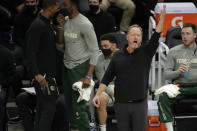 Milwaukee Bucks' head coach Mike Budenholzer gestures to his team during the first half of Game 5 of the NBA Eastern Conference Finals against the Atlanta Hawks Thursday, July 1, 2021, in Milwaukee. (AP Photo/Aaron Gash)