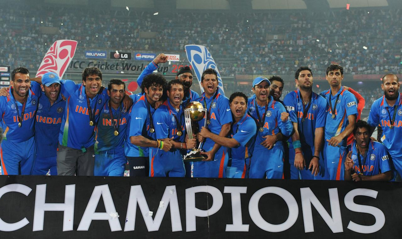 Indian cricketers pose with the trophy after victory in the Cricket World Cup 2011 final over Sri Lanka at The Wankhede Stadium in Mumbai on April 2, 2011. India beat Sri Lanka by six wickets.  AFP PHOTO/Indranil MUKHERJEE (Photo credit should read INDRANIL MUKHERJEE/AFP/Getty Images)