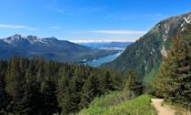 """<p><a href=""""https://www.tripadvisor.com/Attraction_Review-g31020-d105338-Reviews-Mount_Roberts_Trail-Juneau_Alaska.html"""" rel=""""nofollow noopener"""" target=""""_blank"""" data-ylk=""""slk:Mount Roberts Trail"""" class=""""link rapid-noclick-resp"""">Mount Roberts Trail</a>, starting in downtown Juneau and reaching a height of 1,760 feet, is guaranteed to take your breath away. The sight of the snow-capped mountains can't be beat—plus, if you reach the top and you're exhausted, you'll be happy to know that you can hitch a ride on a <a href=""""http://mountrobertstramway.com/"""" rel=""""nofollow noopener"""" target=""""_blank"""" data-ylk=""""slk:tram"""" class=""""link rapid-noclick-resp"""">tram</a> and head back down in comfort. (NOTE: Tram is closed until spring 2021.)</p><p><br><a class=""""link rapid-noclick-resp"""" href=""""https://go.redirectingat.com?id=74968X1596630&url=https%3A%2F%2Fwww.tripadvisor.com%2FAttraction_Review-g31020-d105338-Reviews-Mount_Roberts_Trail-Juneau_Alaska.html&sref=https%3A%2F%2Fwww.countryliving.com%2Flife%2Ftravel%2Fg24487731%2Fbest-hikes-in-the-us%2F"""" rel=""""nofollow noopener"""" target=""""_blank"""" data-ylk=""""slk:PLAN YOUR HIKE"""">PLAN YOUR HIKE</a></p>"""