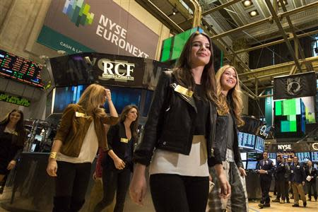 2014 Sports Illustrated Swimsuit Models tour the floor of the New York Stock Exchange February 13, 2014. REUTERS/Brendan McDermid
