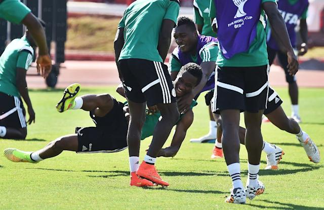 Nigeria's midfielder John Obi Mikel (C) collides with a teammate as they play a game of handball during a training session in Brasilia on June 29, 2014, a day before their match against France at the FIFA World Cup in Brazil (AFP Photo/Jewel Samad)