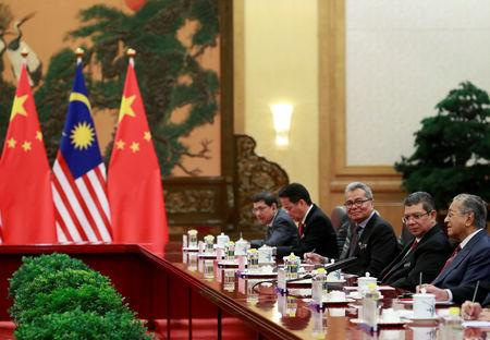 Malaysia's Prime Minister Mahathir Mohamad speaks to China's Premier Li Keqiang (not pictured) during their meeting at the Great Hall of the People in Beijing, China, August 20, 2018. How Hwee Young/Pool via REUTERS