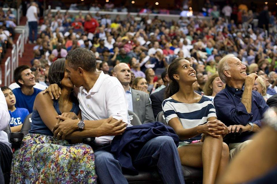 <p>When they appeared on the Kiss Cam at a basketball game and they gamely delivered. [Photo: The White House/Pete Souza]</p>