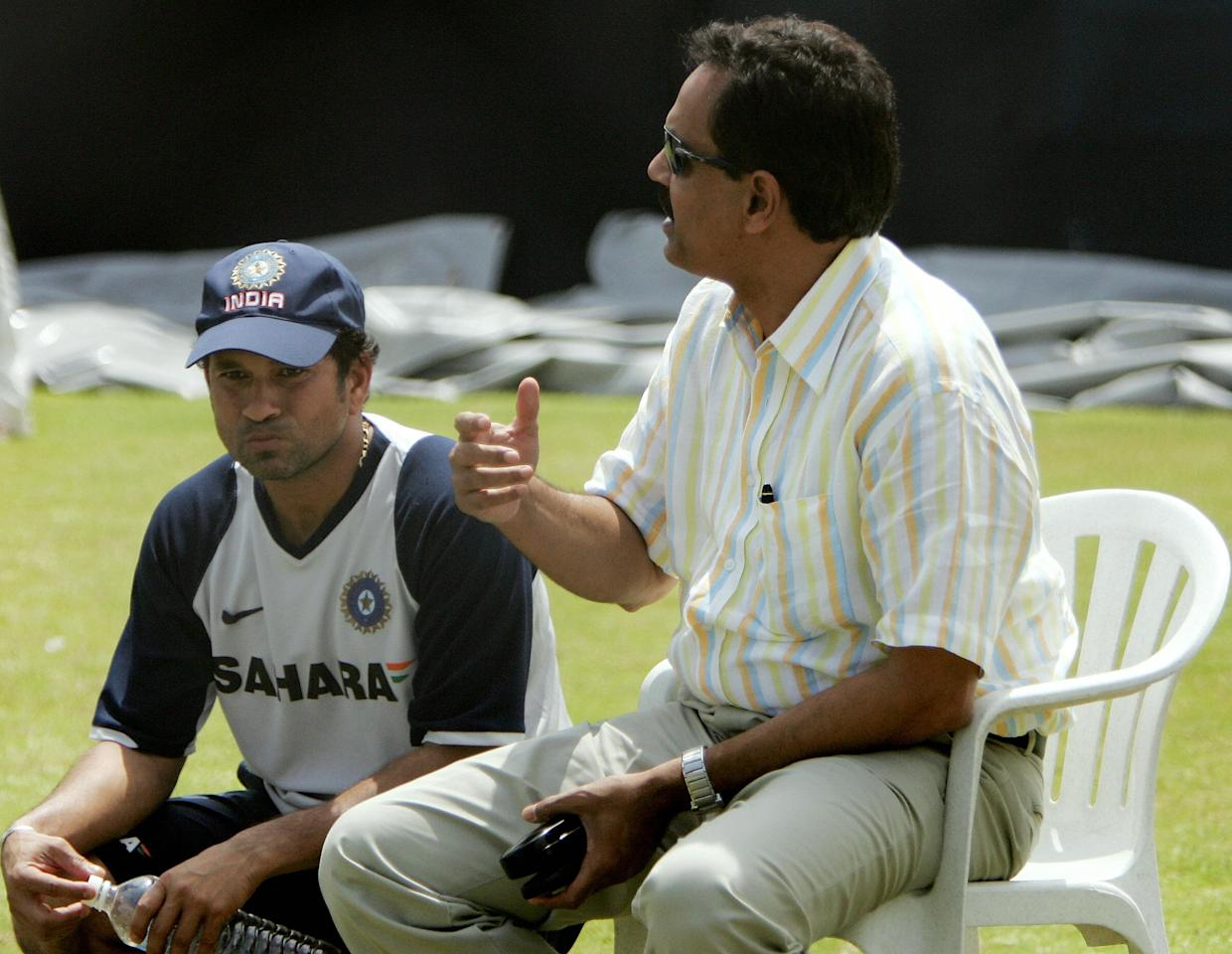 Indian cricketer Sachin Tendulkar (L) listens as Chairman of Indian Selectors Dilip Vengsarkar speaks during a training session at The Rajiv Gandhi International cricket stadium in Hyderabad, 04 October 2007, on the eve of the third one-day international cricket match between India and Australia.     Australia lead the seven match one-day series 1-0 with first match being abandoned by rain   AFP PHOTO/ MANAN VATSYAYANA. (Photo credit should read MANAN VATSYAYANA/AFP/Getty Images)