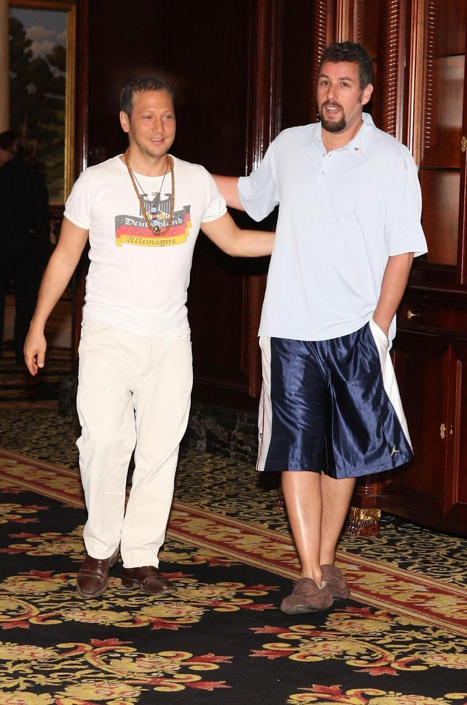 <p>Even when Sandler's abroad, he's all about being comfy. He was spotted with his longtime buddy Rob Schneider at the Berlin premiere of <i>You Don't Mess With the Zohan</i> in 2008, wearing his favorite slippers. (Photo: Anita Bugge/WireImage)</p>
