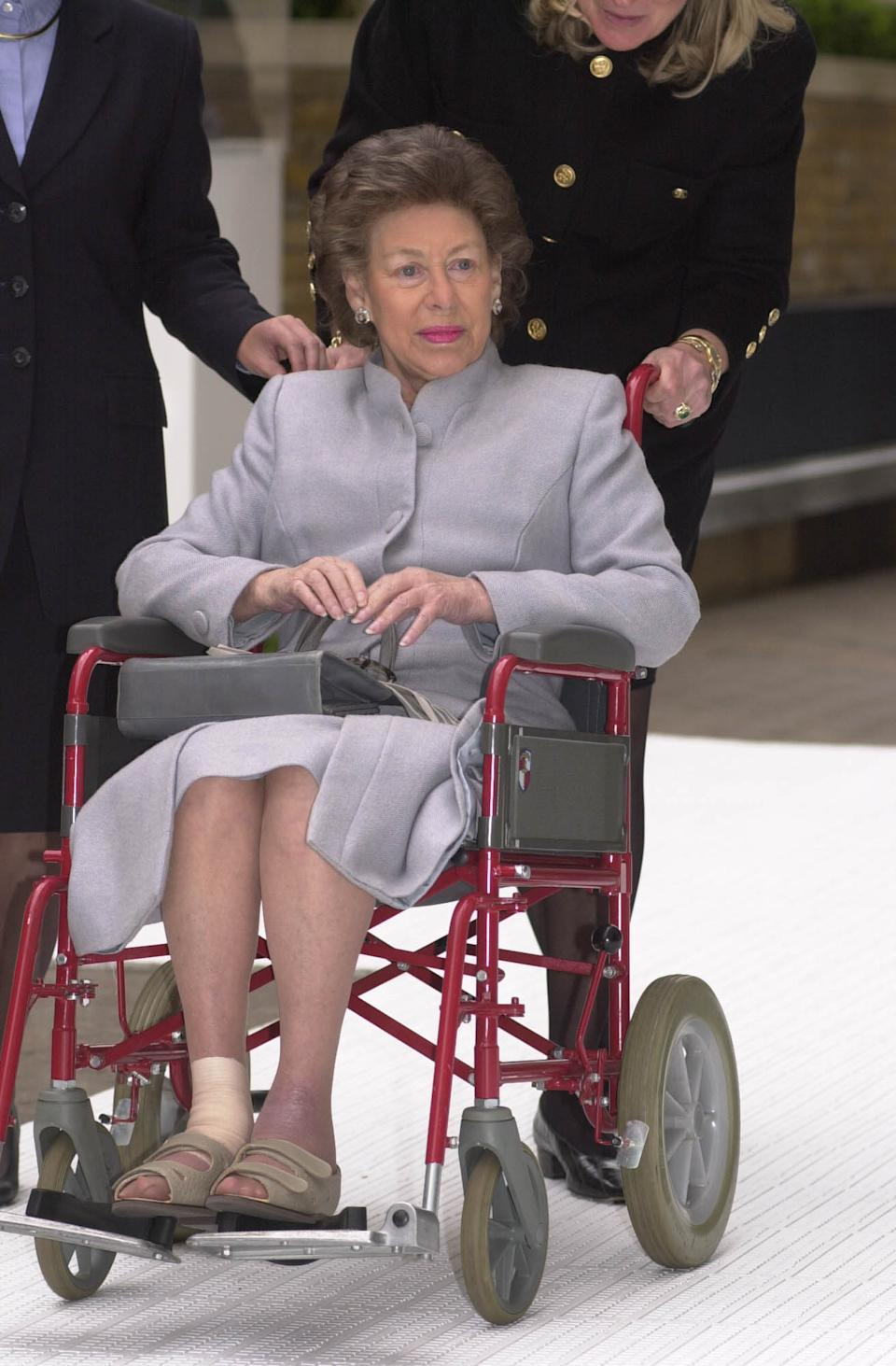 Princess Margaret making a rare public appearance, in her wheelchair, for part of her visit to the Chelsea Harbour Design Centre, London. The Princess badly burnt her feet while on the Caribbean island of Mustique in 1999.   (Photo by John Stillwell - PA Images/PA Images via Getty Images)