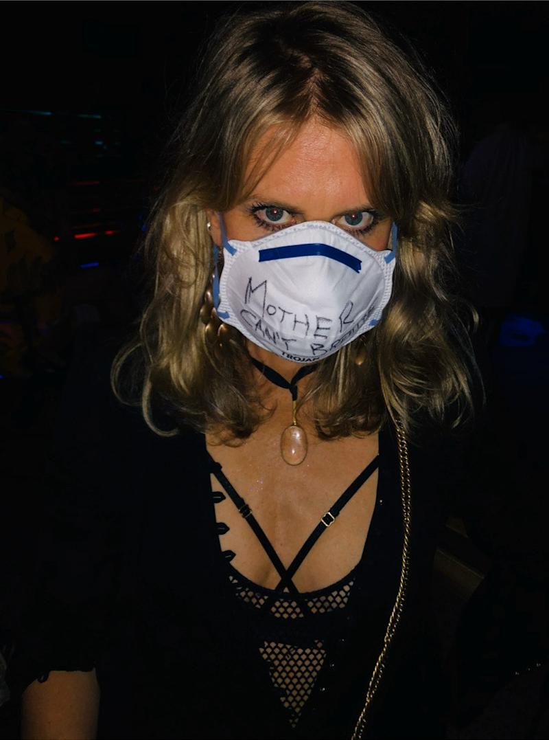 """The writing on Willow's mask reads """"Mother Can't Breathe"""""""