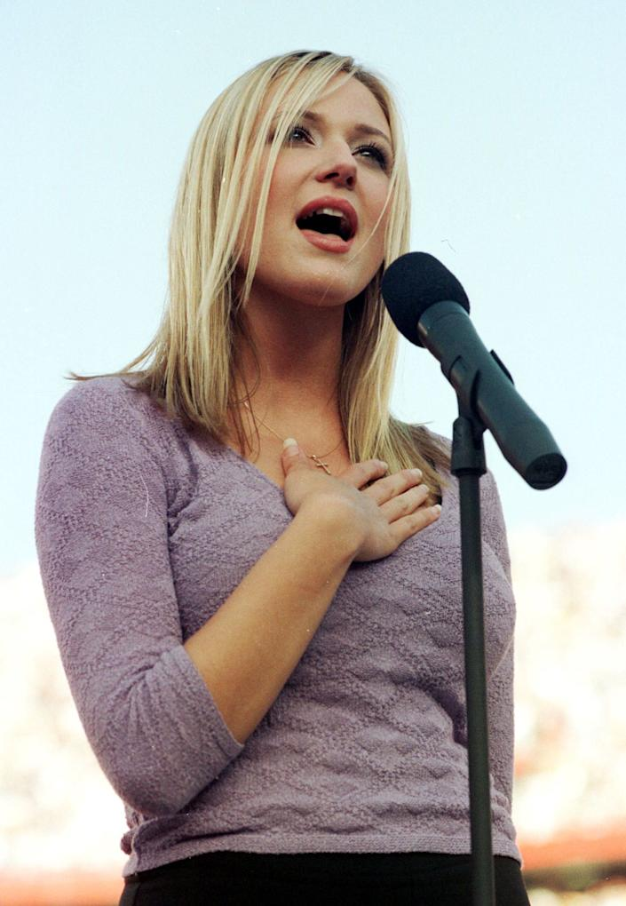 US folk singer Jewel performs the US national anthem on Jan. 25, 1998  before Super Bowl XXXII at Qualcomm Stadium in San Diego, California. The defending champion Green Bay Packers played the Denver Broncos.
