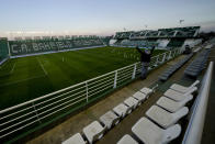 A member of Banfield's soccer team celebrates a goal against Club Atletico Platense during a local tournament game inside the Florencio Sola stadium, empty due to COVID-19 restrictions in Banfield, Argentina, Saturday, Aug. 28, 2021. Argentina is one of the few countries in the region where all professional soccer is still played wholly without fans. (AP Photo/Natacha Pisarenko)