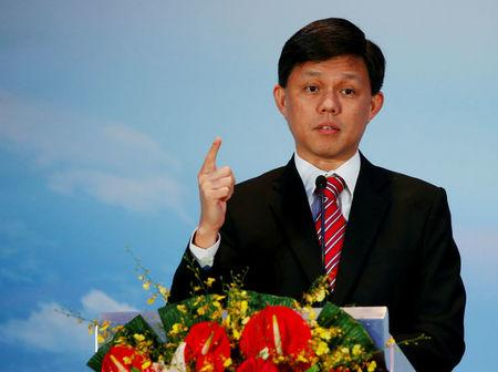 FILE PHOTO: Singapore's Minister Chan Chun Sing speaks before a MOU signing ceremony between Singapore Exchange Limited (SGX) and China Construction Bank Corp (CCB) in Singapore April 25, 2016. REUTERS/Edgar Su/File Photo