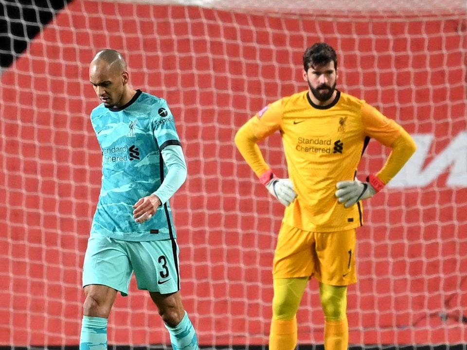 Liverpool players Fabinho and Alisson (The FA via Getty Images)