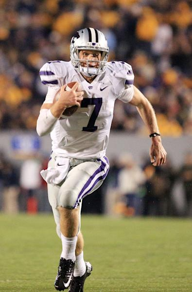 Kansas State quarterback Collin Klein runs with the ball during an NCAA college football game against West Virginia in Morgantown, W.Va., Saturday, Oct. 20, 2012. Kansas State won 55-14. (AP Photo/Christopher Jackson)