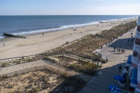 The beach and boardwalk are seen, Friday, Nov. 13, 2020, in Rehoboth Beach, Del. President-elect Joe Biden owns a $2.7 million, Delaware North Shores home with a swimming pool that overlooks Cape Henlopen State Park, is blocks from the ocean and a short drive from downtown Rehoboth Beach.(AP Photo/Alex Brandon)