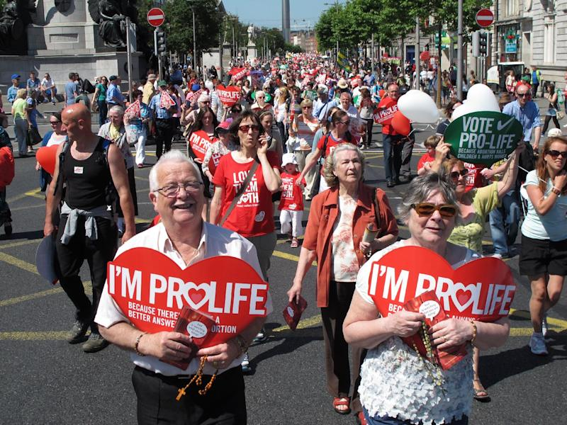 Stephen and Pauline O'Brien, foreground, hold Catholic rosary beads as they march through Ireland's capital, Dublin, in an anti-abortion protest Saturday, July 6, 2013. More than 35,000 activists marched to the parliament building to oppose Irish government plans to enact a bill legalizing terminations for women in life-threatening pregnancies. The Protection of Life During Pregnancy Bill is expected to be passed into law next week. (AP Photo/Shawn Pogatchnik)