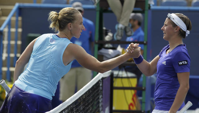 Svetlana Kuznetsova, of Russia, left, shakes hands with Kirsten Flipkens, of Belgium, after defeating her 6-4, 7-5 at the Citi Open tennis tournament, Thursday, July 31, 2014, in Washington. (AP Photo/Luis M. Alvarez)
