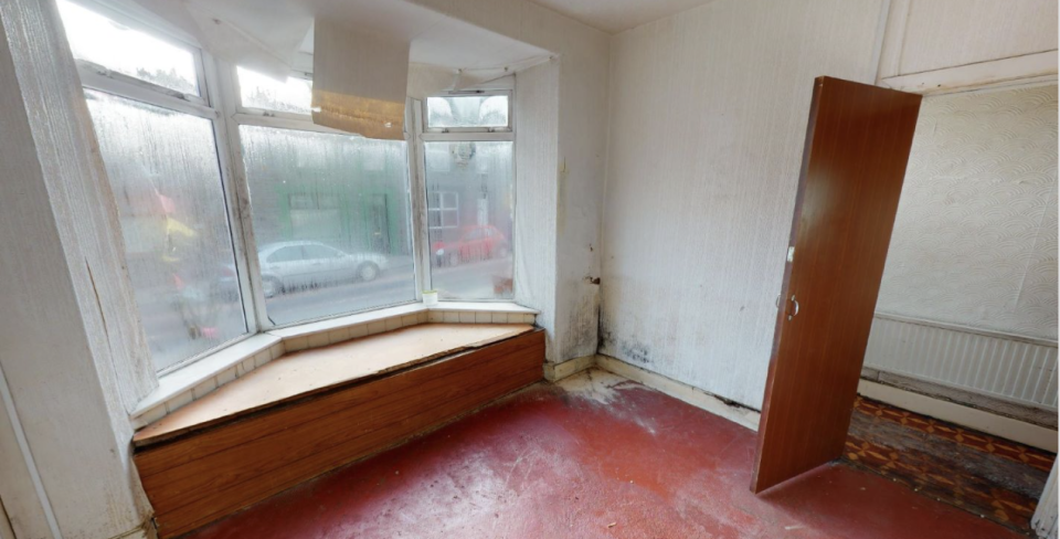 The home features two reception areas, though the property may require updating. Source: Paul Fosh Auctions