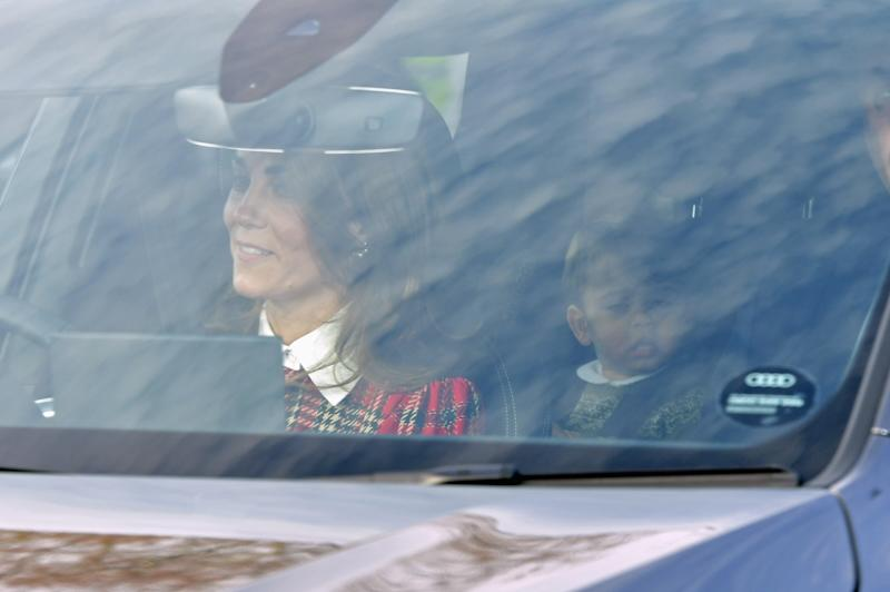 The Duchess of Cambridge arrived in a festive tartan ensemble. [Photo: PA]