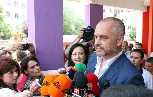 Albanian Socialist Party leader Edi Rama speaks to the media after casting his ballot at a polling station in Tirana on June 23, 2013