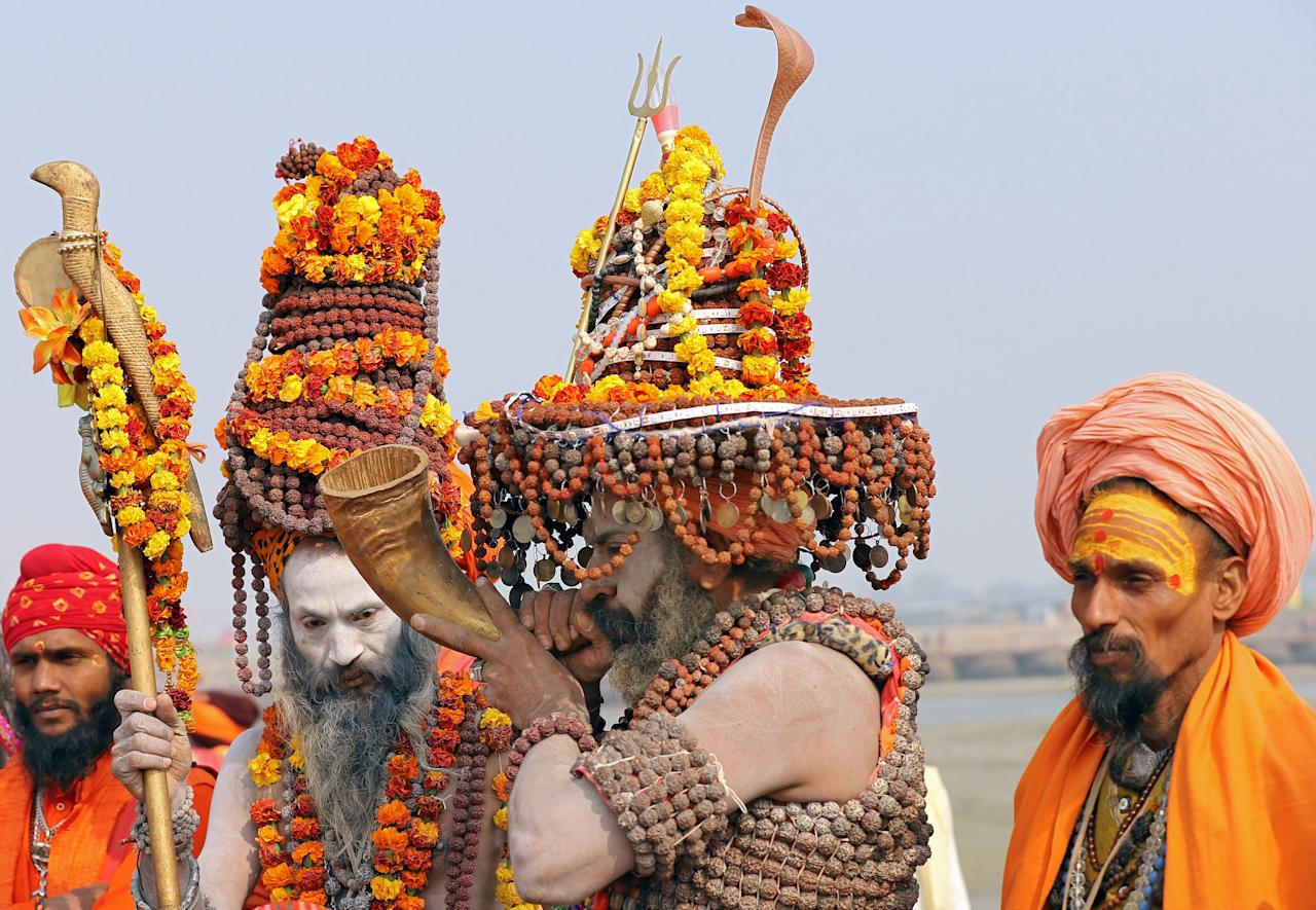 """<p>A Naga Sadhu or a Hindu holy man, wearing prayer beads, plays a traditional instrument on the banks of the river Ganges ahead of the """"Kumbh Mela"""", or the Pitcher Festival, in Prayagraj, previously known as Allahabad, India, January 9, 2019. REUTERS/Jitendra Prakash </p>"""