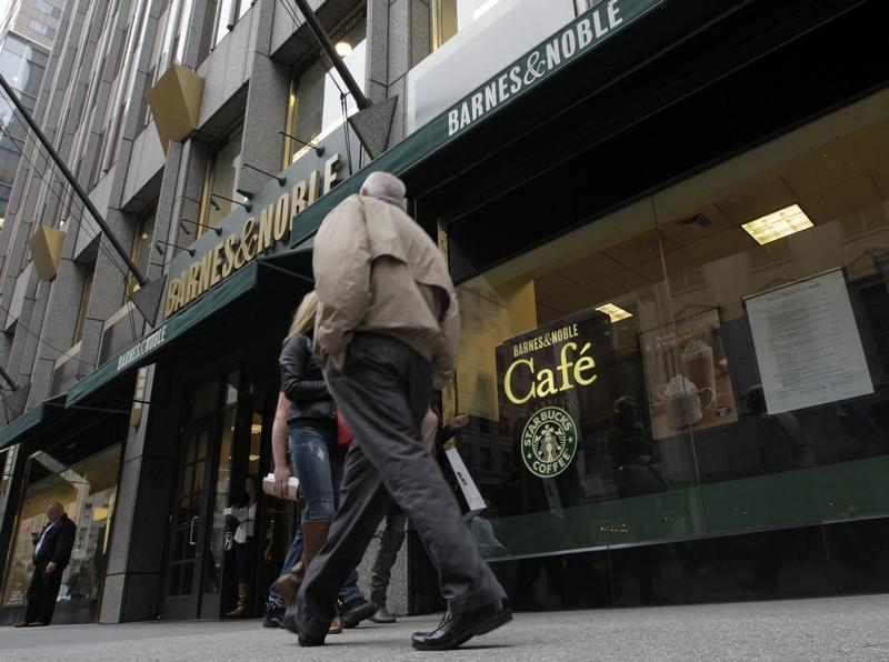 People walk past a Barnes and Noble store in New York