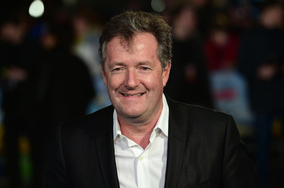British journalist and television personality Piers Morgan poses for a photograph as he arrives for the European premiere of Eddie The Eagle in London on March 17, 2016. / AFP / LEON NEAL        (Photo credit should read LEON NEAL/AFP/Getty Images)