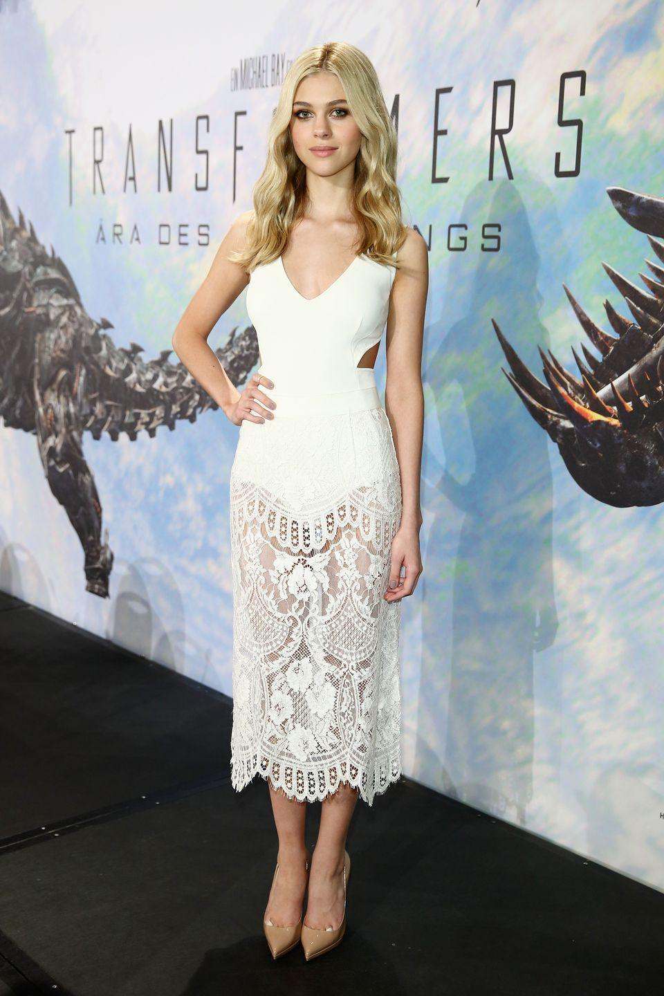 <p>Peltz opted for a Stella McCartney white bodysuit and Dolce & Gabbana lace skirt to the Transformers film's Berlin press conference.<br></p>