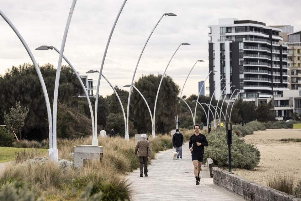 People are seen exercising in Port Melbourne, Monday, August 30, 2021. Source: AAP