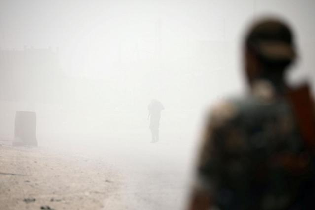 <p>Syrian Democratic Forces (SDF) fighters stand amid smoke in Raqqa's western neighbourhood of Jazra, Syria June 11, 2017. (Photo: Rodi Said/Reuters) </p>