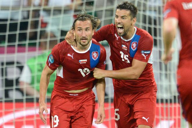 Czech midfielder Petr Jiracek (L) celebrates with Czech forward Milan Baros after scoring a goal during the Euro 2012 championships football match between the Czech Republic and Poland on June 16, 2012 at the Municipal  Stadium in Wroclaw.      TOPSHOTS/AFP PHOTO/JANEK SKARZYNSKIJANEK SKARZYNSKI/AFP/GettyImages