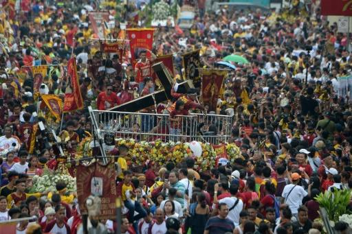 Hundreds of thousands of faithful were packed along the route for the procession of the so-called Black Nazarene, which they believe grants miracles
