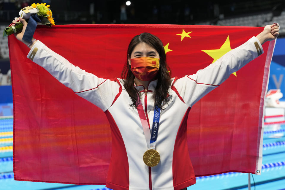 Zhang Yufei, of China, poses with the gold medal after winning the women's 200-meter butterfly final at the 2020 Summer Olympics, Thursday, July 29, 2021, in Tokyo, Japan. (AP Photo/Martin Meissner)