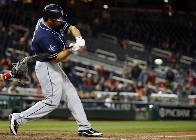 San Diego Padres' Xavier Nady hits an RBI single to score the winning during the 12th inning of a baseball game against the Washington Nationals at Nationals Park on Thursday, April 24, 2014, in Washington. The Padres won 4-3 in 12 innings. (AP Photo/Alex Brandon)