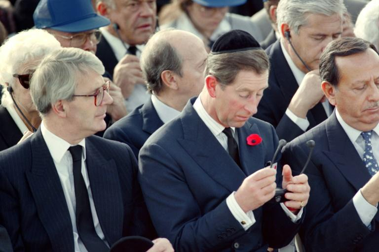 Prince William's father Prince Charles (C) and then-British prime minister John Major (L) attend the funeral of late Israeli prime minister Yitzhak Rabin at the Jerusalem Mount Herzl military cemetery on November 6, 1995