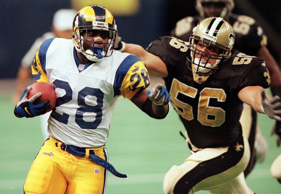 Marshall Faulk had a career-high 2,429 yards from scrimmage in the Rams' Super Bowl season of 1999. (AP)