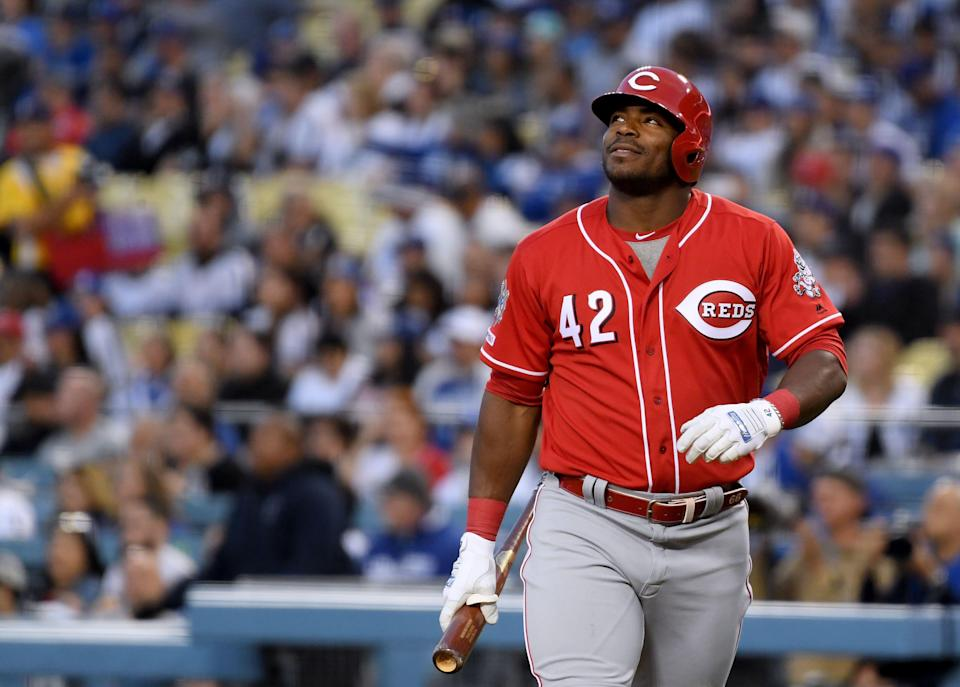 LOS ANGELES, CALIFORNIA - APRIL 15:  Yasiel Puig #24 of the Cincinnati Reds reacts during his first at bat in his return to play his former team on Jackie Robinson Day at Dodger Stadium on April 15, 2019 in Los Angeles, California. All players are wearing the number 42 in honor of Jackie Robinson Day. (Photo by Harry How/Getty Images)