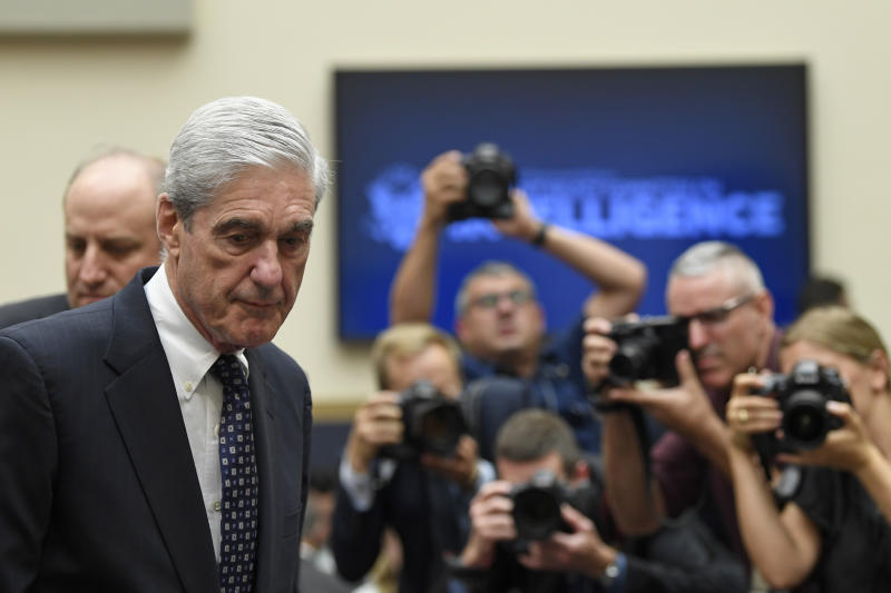 Former special counsel Robert Mueller returns to the witness table following a break in his testimony before the House Intelligence Committee on Capitol Hill in Washington, Wednesday, July 24, 2019. Mueller testified about his report on Russian election interference. (AP Photo/Susan Walsh)