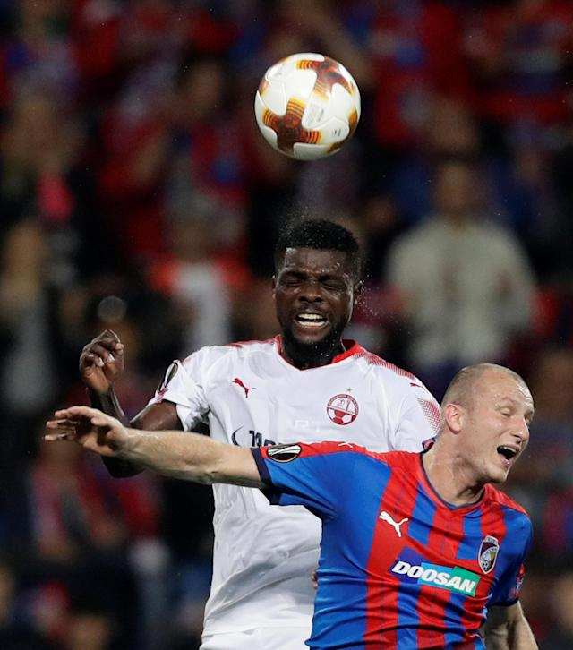 Soccer Football - Europa League - Viktoria Plzen vs Hapoel Be'er Sheva - Doosan Arena, Pizen, Czech Republic - September 28, 2017 Viktoria Plzen's Michal Krmencik in action with Hapoel Be'er Sheva's John Ogu REUTERS/David Cerny