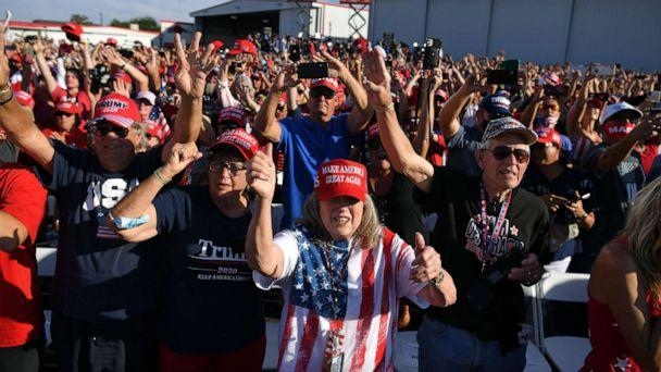 PHOTO: Supporters of President Donald Trump cheer during a rally at Prescott Regional Airport in Prescott, Arizona on Oct. 19, 2020. (Mandel Ngan/AFP via Getty Images)