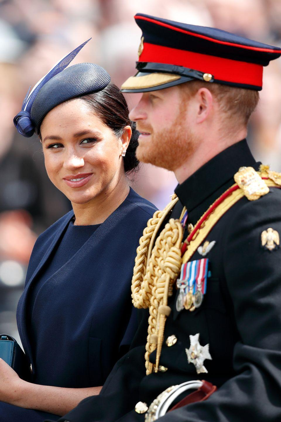 <p>Meghan steals a glance at Harry as they travel down The Mall in a horse drawn carriage during Trooping The Colour.</p>