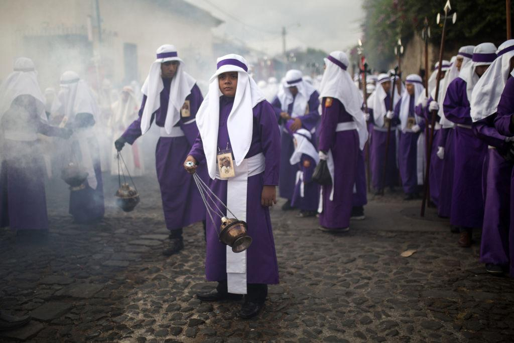 <p>Worshipers wave incense at a Good Friday procession during Holy Week celebrations in Antigua, Guatemala, on Friday, March 30, 2018. In Antigua, more than half a million visitors visit the UNESCO World Heritage Site for Holy Week. Photo from James Rodriguez/Bloomberg/Getty Images. </p>