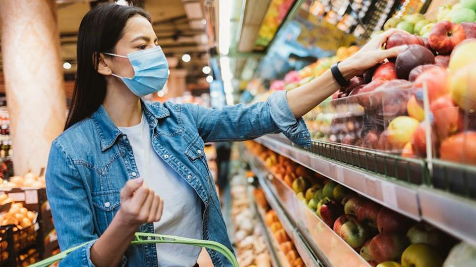 Stock image of a woman buying fruit