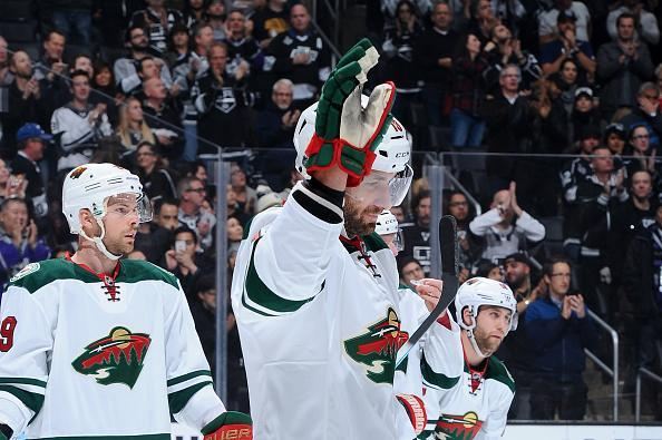 LOS ANGELES, CA - JANUARY 21: Jarret Stoll #19 of the Minnesota Wild waves to the crowd during the game against the Los Angeles Kings on January 21, 2016 at Staples Center in Los Angeles, California. (Photo by Juan Ocampo/NHLI via Getty Images)