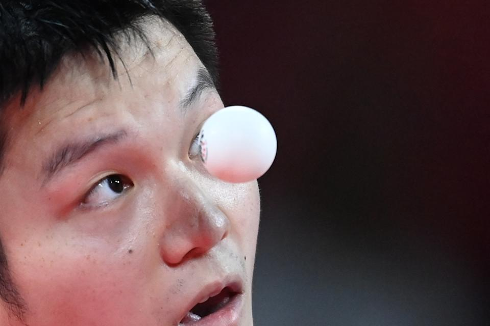 <p>China's Fan Zhendong serves to South Korea's Jang Woo-jin during their men's team semifinal table tennis match at the Tokyo Metropolitan Gymnasium during the Tokyo 2020 Olympic Games in Tokyo on August 4, 2021. (Photo by ADEK BERRY / AFP)</p>