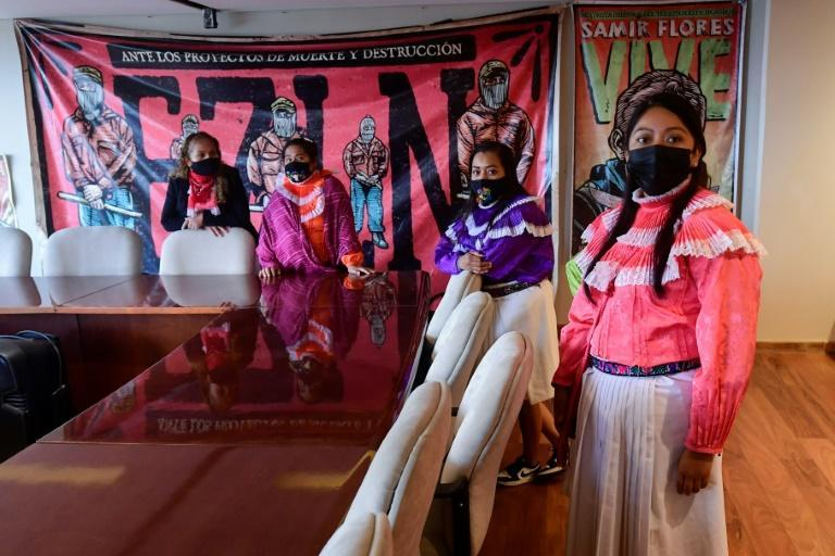 Mexican woman from the Otomi indigenous community are seen in the occupied National Institute of Indigenous Peoples building in Mexico City (AFP/PEDRO PARDO)