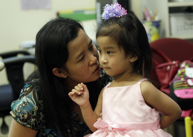 Angelica Sabuco, 2, listens to her mom Ginady at Lucile Packard Children's Hospital Monday, April 30, 2012 in Palo Alto, Calif.  Angelica and her twin sister Angelina  were born joined in the chest and abdomen. They were separated by doctors at the Palo Alto hospital during an intricate 10-hour procedure in December 2011. (AP Photo/Marcio Jose Sanchez)